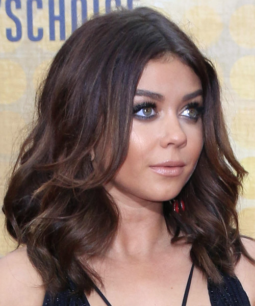 Sarah Hyland voluminous waves with a center part and long sweeping bangs