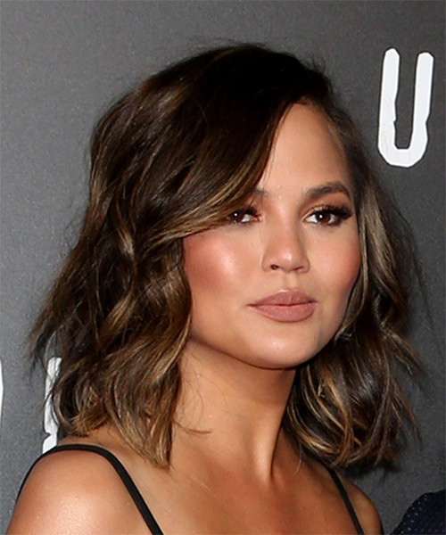 Christine Teigen Medium Wavy   Dark Brunette Bob  Haircut with Side Swept Bangs  - Side on View