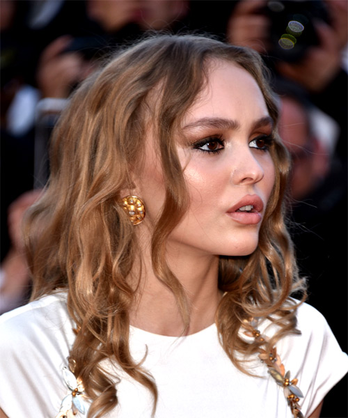 Lily Rose Depp Medium Wavy Casual   Hairstyle   - Dark Blonde - Side on View
