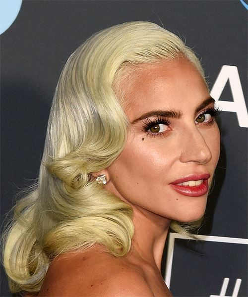 Lady Gaga Medium Wavy Casual    Hairstyle with Side Swept Bangs  - Light Blonde and Yellow Two-Tone Hair Color - Side on View