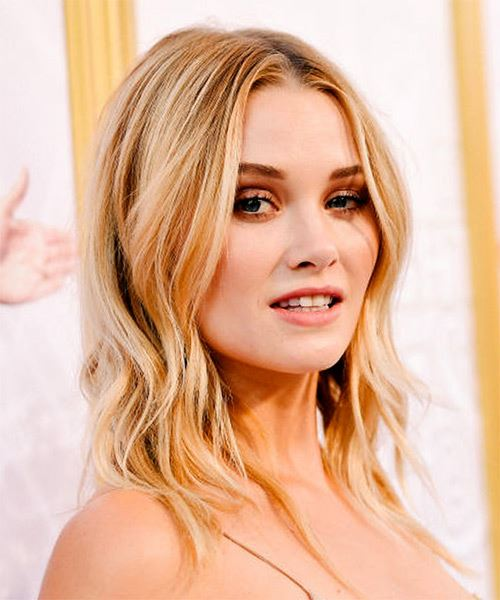 Virginia Gardner Long Wavy    Blonde   Hairstyle with Layered Bangs  and Light Blonde Highlights - Side on View