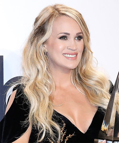 Carrie Underwood Long Wavy    Blonde   Hairstyle with Side Swept Bangs  and Light Blonde Highlights - Side on View