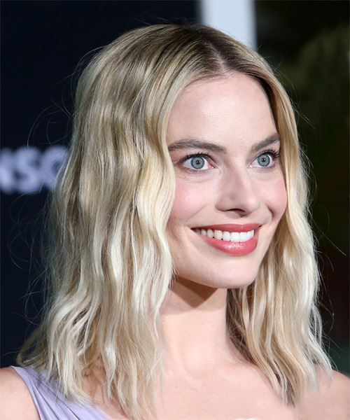 Margot Robbie Medium Wavy   Light Blonde   Hairstyle with Blunt Cut Bangs  - Side on View