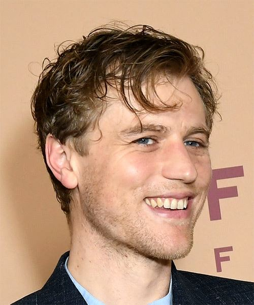 Johnny Flynn Short Wavy   Dark Brunette   Hairstyle with Side Swept Bangs  - Side on View