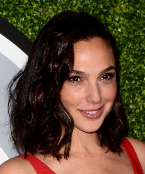 Gal Gadot Medium Wavy Layered  Black  Bob  Haircut with Side Swept Bangs  - Side on View
