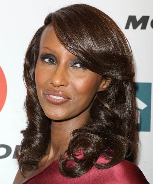 Iman Long Wavy Hairstyle with Side Swept Bangs