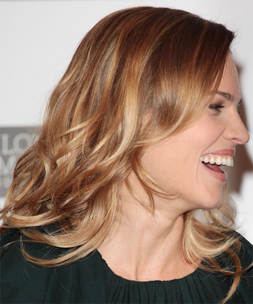 Hilary Swank Medium Wavy Casual    Hairstyle   - Light Caramel Brunette Hair Color with  Blonde Highlights - Side on View