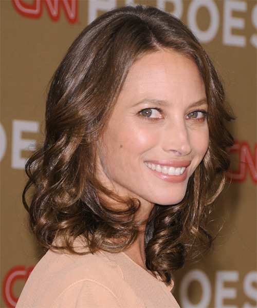 Christy Turlington Medium Wavy Casual    Hairstyle   - Medium Chocolate Brunette Hair Color - Side on View
