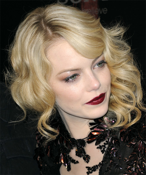 Emma Stone Medium Wavy    Golden Blonde   Hairstyle with Side Swept Bangs  and Light Blonde Highlights - Side on View