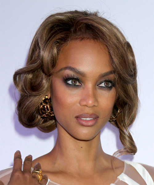 Tyra Banks  Long Curly Formal   Updo Hairstyle with Side Swept Bangs  - Medium Caramel Brunette Hair Color with Medium Blonde Highlights - Side on View