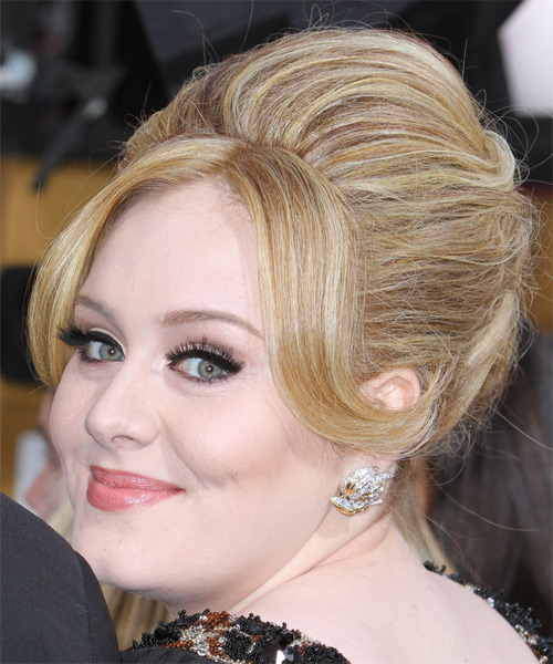 Adele wears a beehive puff hairstyle to a formal event