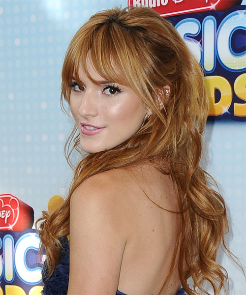 Bella Thorne Long Wavy Casual   Hairstyle with Blunt Cut Bangs  - Dark Blonde (Copper) - Side on View