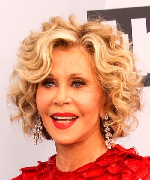 Jane Fonda Medium Curly    Blonde Bob  Haircut with Side Swept Bangs  - Side View