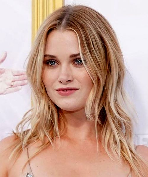 Virginia Gardner Long Wavy    Blonde   Hairstyle with Layered Bangs  and Light Blonde Highlights - Side View