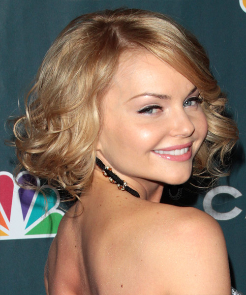 Izabella Miko Medium Curly Formal    Hairstyle with Side Swept Bangs  - Medium Blonde Hair Color - Side View