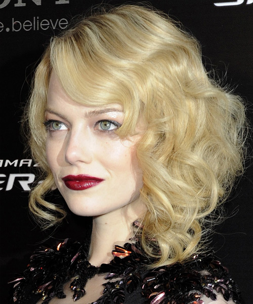 Emma Stone Medium Wavy    Golden Blonde   Hairstyle with Side Swept Bangs  and Light Blonde Highlights - Side View