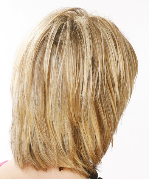 back view of medium layered haircuts medium casual hairstyle with layered bangs 2773