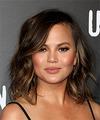 Christine Teigen Medium Wavy   Dark Brunette Bob  Haircut with Side Swept Bangs
